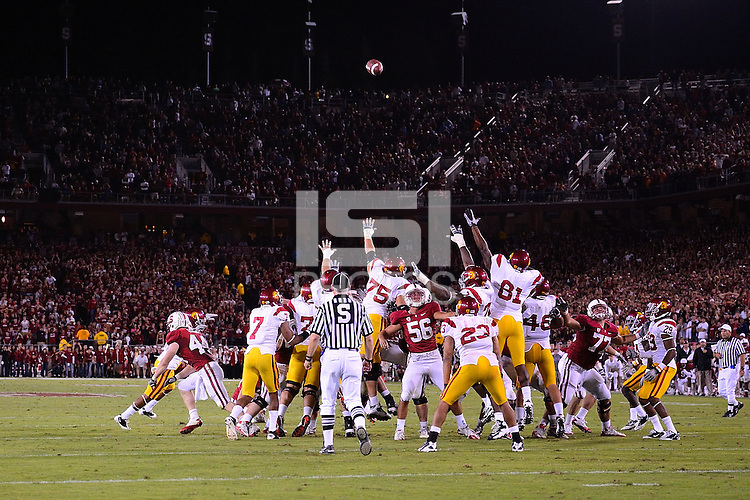 STANFORD, CA - SEPTEMBER 4: Nate Whitaker of Stanford football kicks the game-winning field goal against the USC Trojans on October 9, 2010 at Stanford Stadium / Foster Field in Stanford, CA.  Stanford won 37-35.