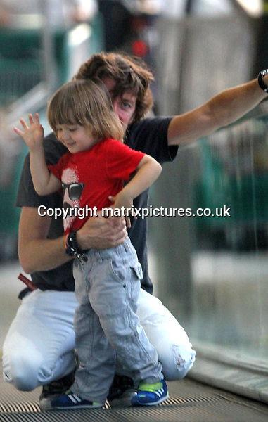 NON EXCLUSIVE PICTURE: MATRIXPICTURES.CO.UK.PLEASE CREDIT ALL USES..UK, AUSTRALIA, NEW ZEALAND AND ASIA RIGHTS ONLY..Businessman Nicolas 'Colate' Vallejo-Nagera is pictured with his son Andrea Nicolas in Miami, Florida...The mexican singer Paulina Rubio's ex husband is seen visiting a supermarket and spending time at the park with his young son...APRIL 10th 2013..REF: KDA 132376..GAR