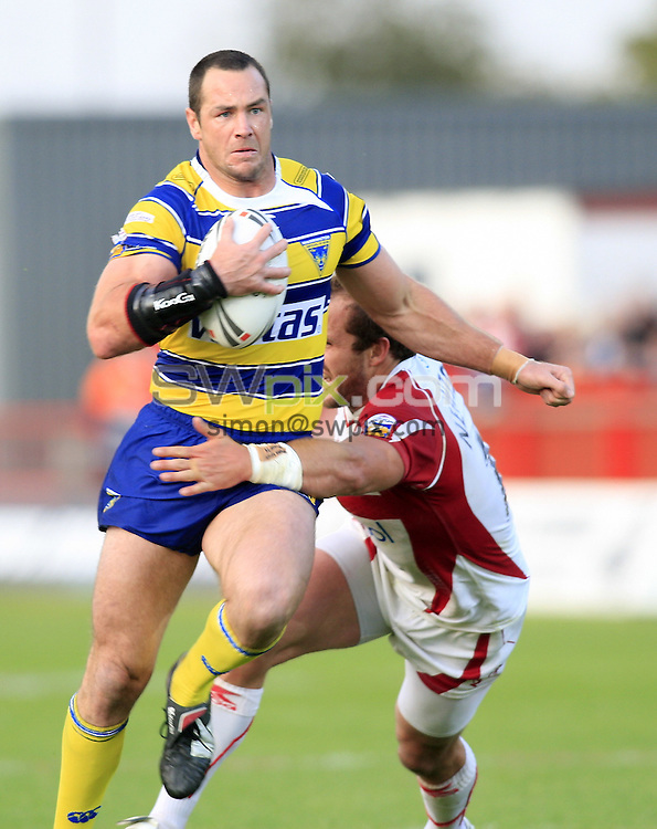 Pix: Chris Mangnall/SWpix.com, Rugby League, Super League. 05/09/09 Hull K R v Warrington Wolves....picture copyright>>Simon Wilkinson>>07811267 706>>....Hull's  Clint Newton  tackles Warrington's Adrian Morley
