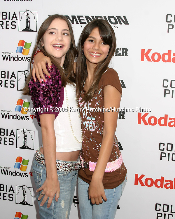 Victoria Justice and Guest arriving at.Shark Boy and Lava Girl Premiere.El Capitan Theater.Los Angeles, CA.June 4, 2005.©2005 Kathy Hutchins / Hutchins Photo