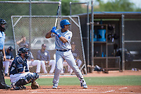 AZL Royals catcher Stephan Vidal (13) at bat in front of catcher Rainier Aguilar (8) and home plate umpire Alan Gorewitz during an Arizona League game against the AZL Padres 1 at Peoria Sports Complex on July 4, 2018 in Peoria, Arizona. The AZL Royals defeated the AZL Padres 1 5-4. (Zachary Lucy/Four Seam Images)