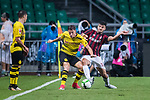 Borussia Dortmund Defender Erik Durm (C) fights for the ball with AC Milan Forward Patrick Cutrone (R) during the International Champions Cup 2017 match between AC Milan vs Borussia Dortmund at University Town Sports Centre Stadium on July 18, 2017 in Guangzhou, China. Photo by Marcio Rodrigo Machado / Power Sport Images