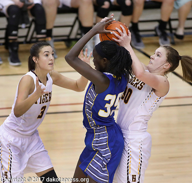 RAPID CITY, SD - MARCH 18, 2017 -- Sebastian Akoi #35 of Sioux Falls O'Gorman battles for a rebound between Sami Slauhter #3 and  Jeniah Ugofsky of Harrisburg during the 2017 South Dakota State Class AA Girls Basketball Championship game Saturday at Barnett Arena in Rapid City, S.D.  (Photo by Dick Carlson/Inertia)