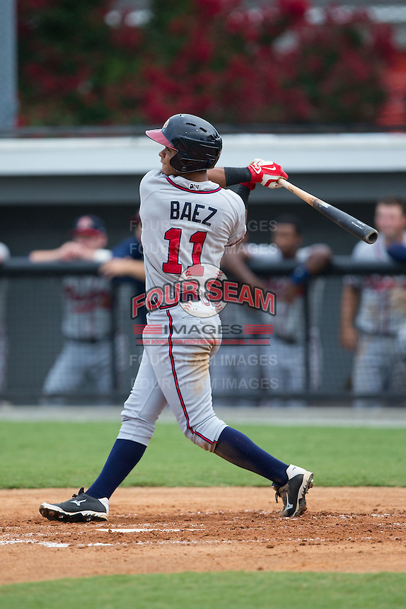 Leudys Baez (11) of the Danville Braves follows through on his swing against the Burlington Royals at Burlington Athletic Park on July 12, 2015 in Burlington, North Carolina.  The Royals defeated the Braves 9-3. (Brian Westerholt/Four Seam Images)