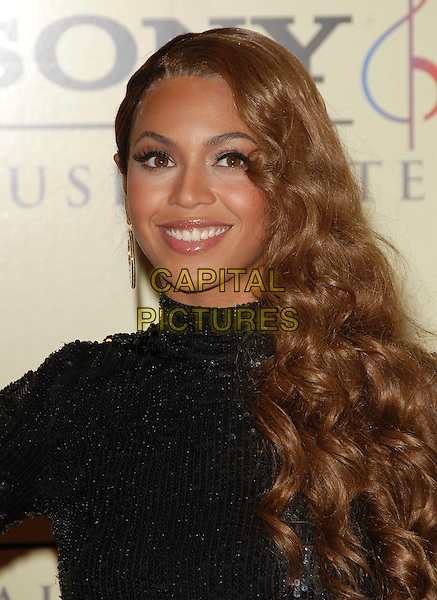 BEYONCE KNOWLES.attends The Sony / BMG Post Grammy Party held at The Beverly Hills Hotel in Beverly Hills, California, USA, February 11 2007..portrait headshot black dress sequined polo neck long earring disc .CAP/DVS.©Debbie VanStory/Capital Pictures