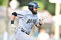 Augusta GreenJackets catcher Matt Winn (16) runs to first base during a game against the Asheville Tourists at McCormick Field on August 5, 2016 in Asheville, North Carolina. The Tourists defeated the GreenJackets 7-6. (Tony Farlow/Four Seam Images)
