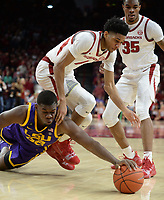 NWA Democrat-Gazette/ANDY SHUPE<br /> Arkansas guard Isaiah Joe (1) and LSU forward Darius Days (22) reach for a loose ball Friday, Jan. 11, 2019, during the second half of play in Bud Walton Arena in Fayetteville. Visit nwadg.com/photos to see more photographs from the game.