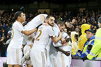 Bafetibis Gomis is engulfed by team mates as he celebrates scoring his sides first goal as during the Barclays Premier League Match between Manchester City and Swansea City played at the Etihad Stadium, Manchester on 12th December 2015. 1-1