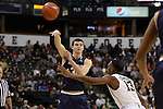 24 February 2016: Notre Dame's Steve Vasturia (left) passes the ball over Wake Forest's Bryant Crawford (13). The Wake Forest University Demon Deacons hosted the University of Notre Dame Fighting Irish at Lawrence Joel Veterans Memorial Coliseum in Winston-Salem, North Carolina in a 2015-16 NCAA Division I Men's Basketball game. Notre Dame won the game 69-58.
