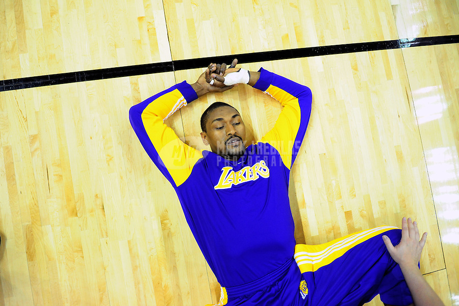 Mar. 24, 2010; San Antonio, TX, USA; Los Angeles Lakers forward Ron Artest stretches prior to the game against the San Antonio Spurs at the AT&T Center. The Lakers defeated the Spurs 92-83. Mandatory Credit: Mark J. Rebilas-US PRESSWIRE