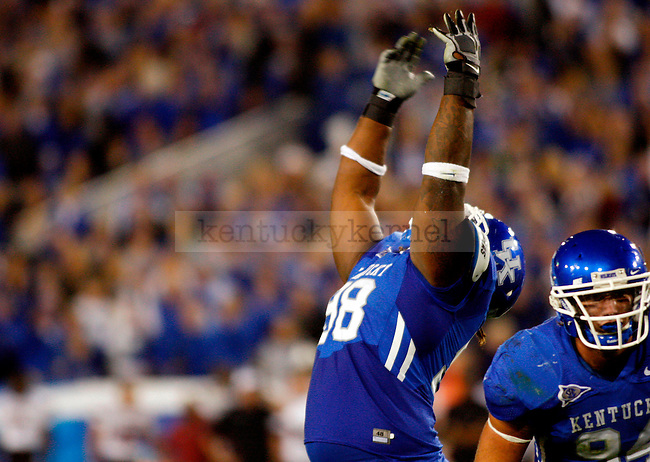 Mark Crawford throws his hands up in celebration in the second half of UK's 31-28 win over  South Carolina football on Saturday, Oct. 16, 2010. Photo by Britney McIntosh | Staff