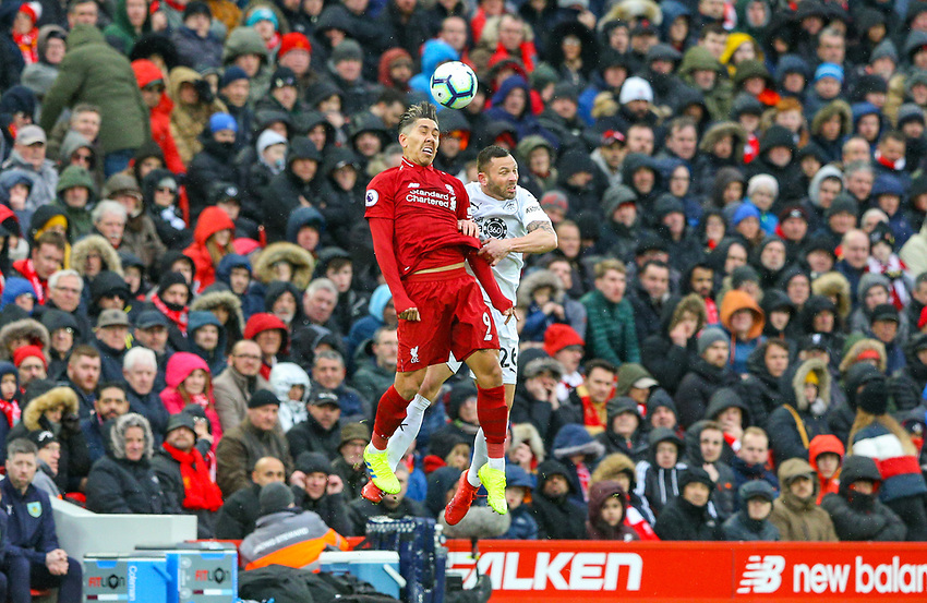 Burnley's Phil Bardsley battles with Liverpool's Roberto Firmino<br /> <br /> Photographer Alex Dodd/CameraSport<br /> <br /> The Premier League - Liverpool v Burnley - Sunday 10th March 2019 - Anfield - Liverpool<br /> <br /> World Copyright © 2019 CameraSport. All rights reserved. 43 Linden Ave. Countesthorpe. Leicester. England. LE8 5PG - Tel: +44 (0) 116 277 4147 - admin@camerasport.com - www.camerasport.com