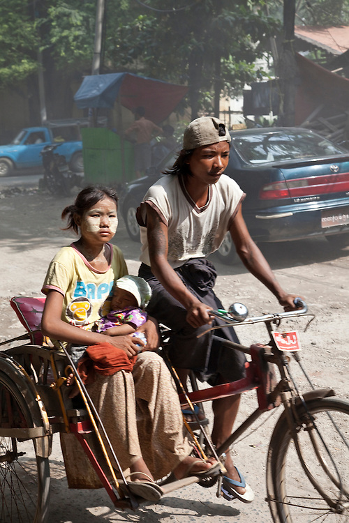 Family on bike with side car in marble carving district of Mandalay,Burma