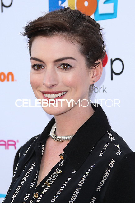 """BURBANK, CA, USA - APRIL 26: Anne Hathaway at the Lollipop Theater Network's Night Under The Stars Screening Of Twentieth Century Fox's """"Rio 2"""" Hosted by Anne Hathaway held at Nickelodeon Animation Studios on April 26, 2014 in Burbank, California, United States. (Photo by Xavier Collin/Celebrity Monitor)"""