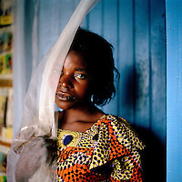 A young woman with fistula, which she contracted as a result of being brutally raped, living in a segregated community outside Goma. Such is the stigma from this condition that women affected have formed their own villages away from the rest of society. An estimated 250,000 women have been victims of sexual violence during the Democratic Republic of Congo's civil war..©Robin Hammond/PANOS/Felix Features