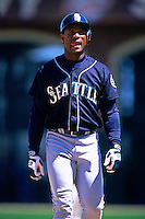 SAN FRANCISCO, CA - Rickey Henderson of the Seattle Mariners walks on the field during a game against the San Francisco Giants at Pacific Bell Park in San Francisco, California on June 10, 2000. Photo by Brad Mangin