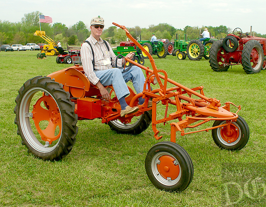 Photo by Randy Moll<br /> Glenn Smith of rural Gentry drove this unique tractor he restored during the Parade of Power held on Friday (April 14, 2017) at the Tired Iron of the Ozarks show in Gentry.