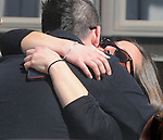 (Medford Ma 042113) Mourners hug outside Delle Russo Funeral Home in Medford for the wake for Boston Marathon victim Krystle Campbell, Sunday in Medford.   (Jim Michaud Photo)