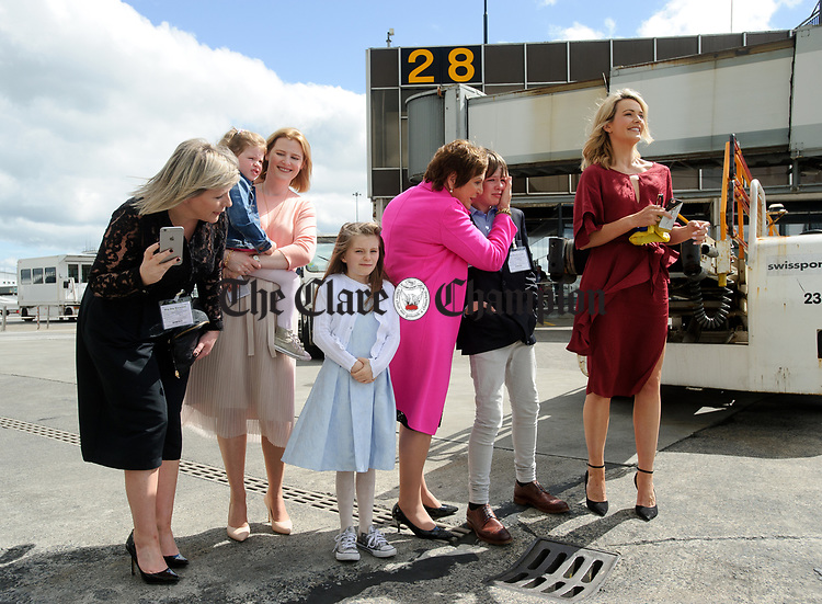 June Curtin, (sister)  Pamela (sister)  Claire Burke, (mother), Callum Curtin, (nephew) and Aoibhin Garrihy, (wife), with nieces Ava and Amelya waiting for John Burke's arrival back to Shannon Airport, following his success in being the first Clare person ever to climb Mount Everest. Photograph by John Kelly.