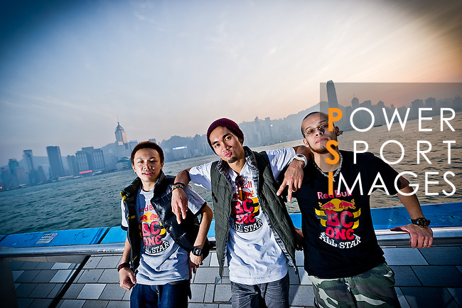 B-Boys Taisuke, Ronnie and Lilou pose on Hong Kong's Victoria Harbour waterfront.