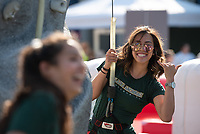 Seawolves Volleyball  player Talia Leauanae climbs the rock wall at UAA's 2019 Campus Kickoff on Cuddy Quad.