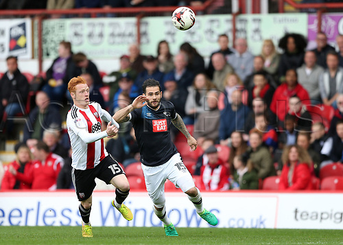 April 14th 2017,  Brent, London, England; Skybet Championship football, Brentford versus Derby County; Ryan Woods of Brentford and Bradley Johnson of Derby County competing for the ball