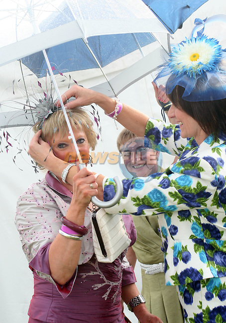 Emily Meade who won third place in the Best Dressed Lady competition is helped by friends, Helen Finnigan and Bernie Reid before the Judging began at the Bellewstown Races...Photo NEWSFILE/Jenny Matthews.(Photo credit should read Jenny Matthews/NEWSFILE)....This Picture has been sent you under the condtions enclosed by:.Newsfile Ltd..The Studio,.Millmount Abbey,.Drogheda,.Co Meath..Ireland..Tel: +353(0)41-9871240.Fax: +353(0)41-9871260.GSM: +353(0)86-2500958.email: pictures@newsfile.ie.www.newsfile.ie.FTP: 193.120.102.198.