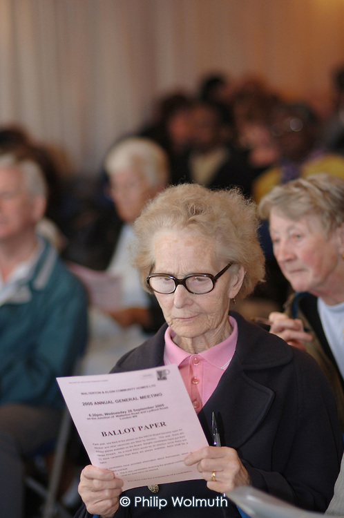 A resident studies a ballot paper before voting for Management Board members at the Walterton and Elgin Community Homes (WECH) 20th AGM.