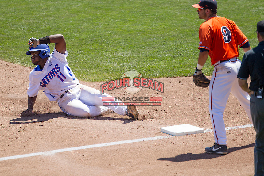 Florida Gators third baseman Josh Tobias (11) slides into third base against the Virginia Cavaliers in Game 11 of the NCAA College World Series on June 19, 2015 at TD Ameritrade Park in Omaha, Nebraska. The Gators defeated Virginia 10-5. (Andrew Woolley/Four Seam Images)