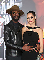 LOS ANGELES, CA - NOVEMBER 13: Gary Clark Jr., Nicole Trunfio, at the Justice League film Premiere on November 13, 2017 at the Dolby Theatre in Los Angeles, California. <br /> CAP/MPI/FS<br /> &copy;FS/MPI/Capital Pictures