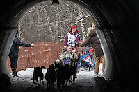 Sarah Stokey runs through the tunnel under Gambell Street during the Ceremonial Start of the 2016 Iditarod in Anchorage, Alaska.  March 05, 2016