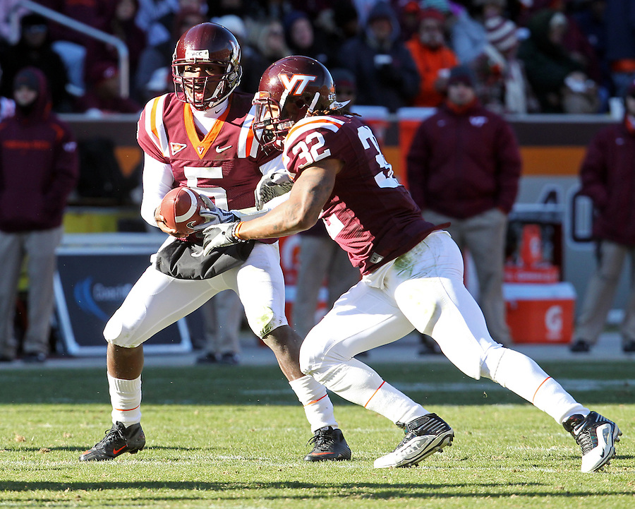 Nov 27, 2010; Charlottesville, VA, USA;  Virginia Tech Hokies quarterback Tyrod Taylor (5) and Virginia Tech Hokies running back Darren Evans (32) during the game against the Virginia Cavaliers at Lane Stadium. Virginia Tech won 37-7. Mandatory Credit: Andrew Shurtleff-