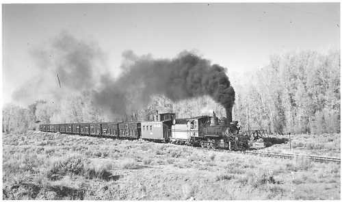 #268 hauling stock cars.  Caboose behind engine.<br /> D&amp;RGW  Elkhorn - Sapinero Branch, CO  Taken by Richardson, Robert W. - 10/9/1953