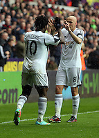 Sunday, 26 April 2014<br /> Pictured L-R: Wilfried Bony of Swansea celebrating his opening goal with co-scorer Jonjo Shelvey.<br /> Re: Barclay's Premier League, Swansea City FC v Aston Villa at the Liberty Stadium, south Wales.