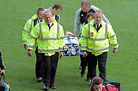 Pictured: Neil Taylor of Swansea is stretchered off after suffering an injury from Peter Odemwingie of West Bromwich Albion. Saturday 17 September 2011<br /> Re: Premiership football Swansea City FC v West Bromwich Albion at the Liberty Stadium, south Wales.
