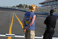 Apr 29, 2007; Talladega, AL, USA; A Nascar Nextel Cup Series fans is handcuffed after being detained for throwing items on the track during the Aarons 499 at Talladega Superspeedway. Mandatory Credit: Mark J. Rebilas