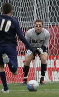 DEC 3, 2005: College Park MD, USA: Maryland Terrapins goalkeeper (0) Chris Seitz keeps his eye on the ball as Akron Zips midfielder (10) Sinisa Ubiparipovic takes a shot at Ludwig Field. Mandatory Credit: Photo By Brad Smith-International Sports Images (c) Copyright 2005 Brad Smith