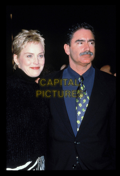 SHARON STONE & PHIL BRONSTEIN.Ref: 7152.turtleneck, black jacket, blue shirt, gold pattern tie, half length, half-length couple.RAW SCAN - PHOTO WILL BE ADJUSTED FOR PUBLICATION.www.capitalpictures.com.sales@capitalpictures.com.©Capital Pictures.