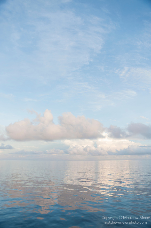 Kondeymathilabadhoo Island, Huvadhoo Atoll, Maldives; cloud formations reflecting in the surface of the Indian Ocean at dawn