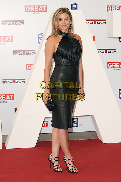 Holly Valance.The UK Creative Industries Reception supported by The Founders Forum, at the Royal Academy of Arts, London, as part of HM Government's GREAT campaign alongside the very best of the UK Creative Industries from the fields of music, film, art and entertainment..30th July 2012 .full length dress leather clutch bag strappy sandals black halterneck.CAP/BEL.©Tom Belcher/Capital Pictures.