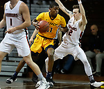 SIOUX FALLS, SD - MARCH 8:  Thomas Collins #11 of West Virginia University Tech drives toward Max Huber #2 of Indiana Tech at the 2018 NAIA DII Men's Basketball Championship at the Sanford Pentagon in Sioux Falls. (Photo by Dick Carlson/Inertia)