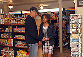 West Tisbury, MA - August 30, 2009 -- United States President Barack Obama and daughter Malia buy some snacks at Alley's General Store August 30, 2009 in West Tisbury, Massachusetts. The president is spending his last day on Martha's Vineyard before returning to Washington later today.  .Credit: Darren McCollester / Pool via CNP