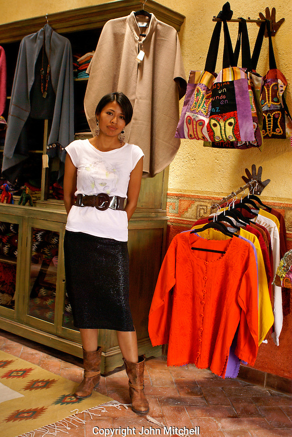 Sales girl Virginia in Sorpresas, a clothing and handicrafts store run by Julie Winslow, Mineral de Pozos, Guanajuato, Mexico