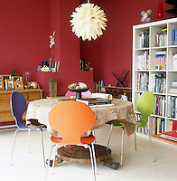 The study/dining room is painted a Russian red and has sliding doors which open onto a terrace
