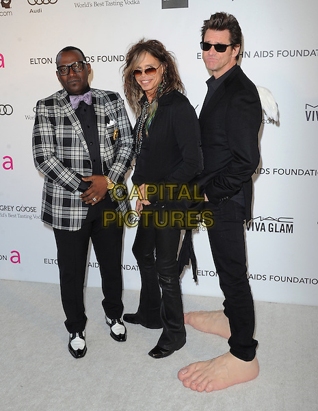 Randy Jackson, Steven Tyler (of Aerosmith) & Jim Carrey.The 21st Annual Elton John AIDS Foundation Academy Awards Viewing Party held at The City of West Hollywood Park in West Hollywood, California, USA..February 24th, 2013.oscars full length grey gray check suit jacket leather trousers scarf necklace side sunglasses shades funny giant large oversized feet make-up prosthetics .CAP/DVS.©DVS/Capital Pictures.