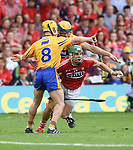 Alan Cadogan of Cork in action against Colm Galvin and Seadna Morey of Clare during their Munster senior hurling final at Thurles. Photograph by John Kelly.