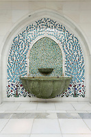 The Sheikh Zayed Grand Mosque in Abu Dhabi, also known as the White Mosque, is a masterpiece of architecture and craftsmanship. A water drinking fountain with a mosaic splashback is framed by tiles using the Iznik form of ceramic decoration, which originates from the 8th century in Anatolia, Turkey.