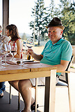 USA, Oregon, Willamette Valley, a man drinks wine on a tour of Sotor Vineyards, Carlton