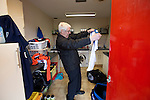 Vauxhall Motors FC 0 Solihull Moors 2, 26/04/2014. Rivacre Park, Conference North. The kit man folding away strips for the last time after Vauxhall Motors played Solihull Moors at Rivacre Park in the final Conference North fixture of the season. It was to be the last match for the Ellesmere Port-based home club, named after the giant car factory in the town, who have resigned from the professional pyramid system to return to local amateur football due to spiralling costs and low attendances. Their final match resulted in a 2-0 home defeat, watched by a crowd of only 215. Photo by Colin McPherson.