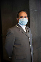 New York, New York City, during the time of Coronavirus. The doormen in New York City are considered to be essential workers and suit up for the job to protect against the COVID virus. They continue to intercept food deliveries, packages, and keep the buildings safe.